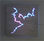 """Energy"", featured in the virtual neon art gallery, this site displays the neon art, neon sculpture and neon art installations of neon artist Eric Ehlenberger, including modern and contemporary art work as well as a line of neon clocks and wall sconces"